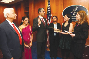 Dr. Vivek Murthy taking Oath by Putting his hand on Bhagavad Gita