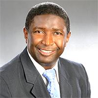 Commissioner Dale V.C. Holness