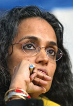 "Indian rights activist and 1997 Booker prize winner Arundhati Roy attends the releasing a report by the Committee Against Violence On Women, an independent group's study, in New Delhi, India, Thursday, Jan. 18, 2007. A militia set up by the government to fight Maoist rebels in the eastern state of Chhattisgarh was preying on poor tribal women the group said Thursday. The ""Salwa Judum,"" an anti-Maoist movement, was set up by the state government in 2005 to combat the rebels. (AP Photo/Mustafa Quraishi)"