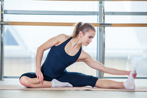 fitness. sport, training and lifestyle concept -  woman doing exercises on mat in gym
