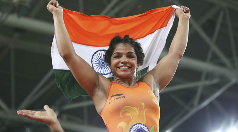 2016 Rio Olympics - Wrestling - Final - Women's Freestyle 58 kg Bronze - Carioca Arena 2 - Rio de Janeiro, Brazil - 17/08/2016. Sakshi Malik (IND) of India celebrates winning the bronze medal. REUTERS/Toru Hanai FOR EDITORIAL USE ONLY. NOT FOR SALE FOR MARKETING OR ADVERTISING CAMPAIGNS.