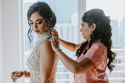 Bridesmaids help Indian Bride Getting Ready
