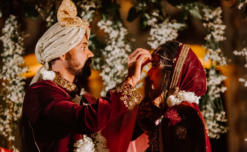 Indian Groom Putting Sindoor On Birde's Maang