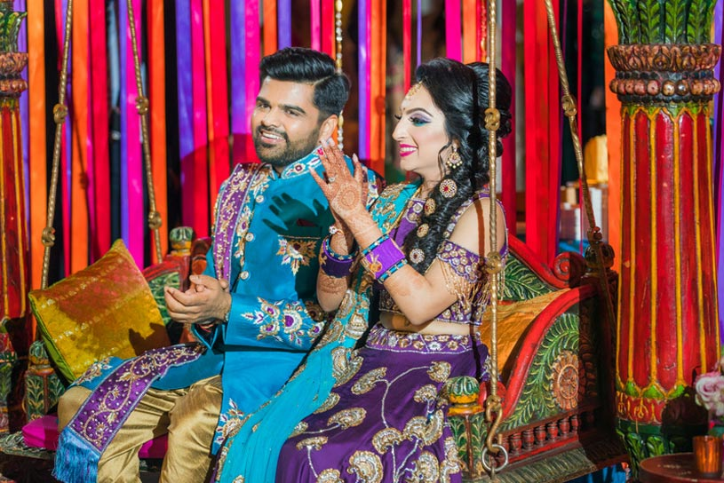 Indian Bride and Groom having fun at the sangeet Celebrations