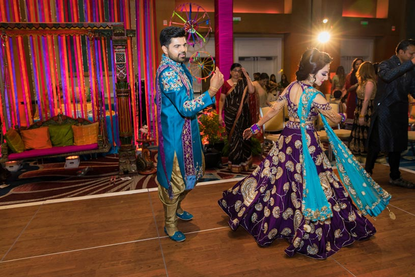 Indian Bride and Groom doing Garba at Sangeet Ceremony