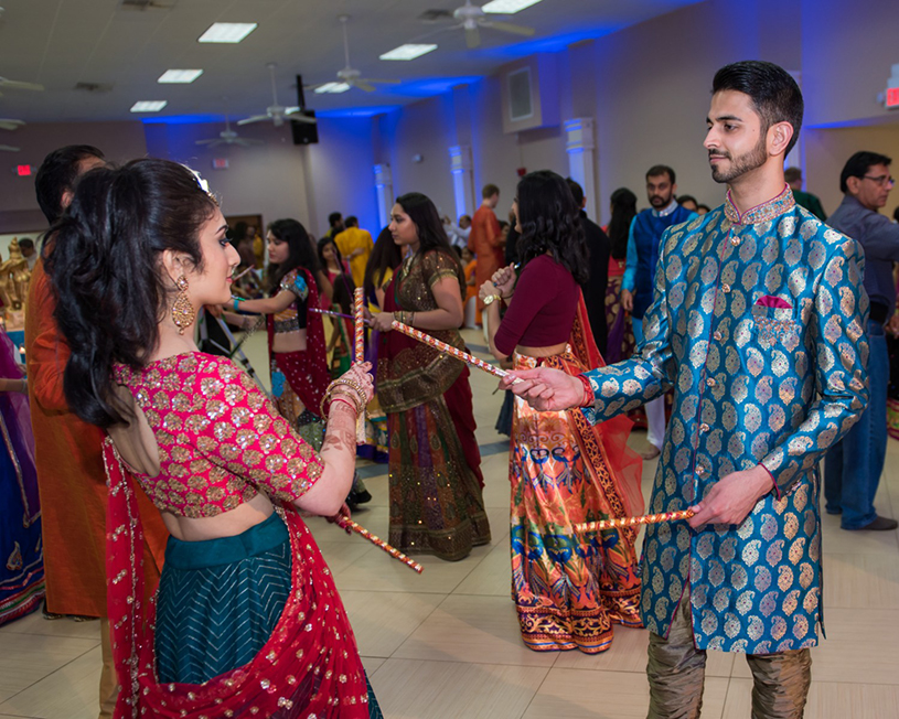 Lovely Indian Couple Playing Raas Garba