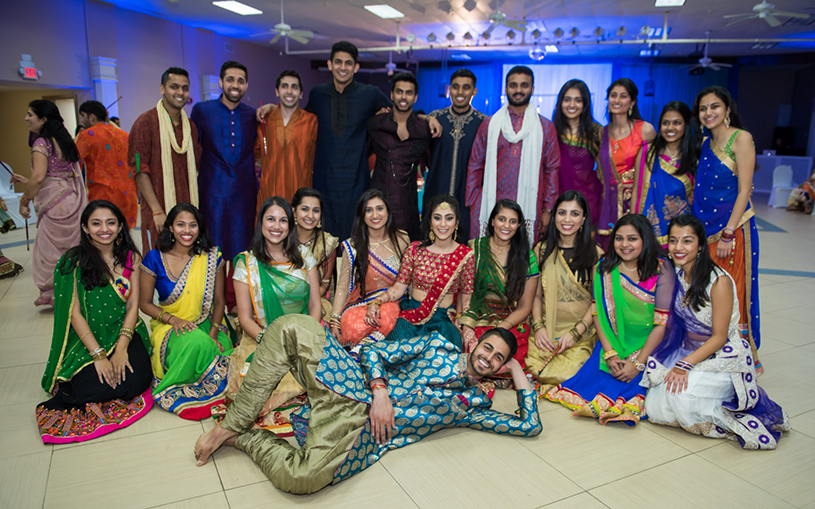 Indian Bride and Groom With Cousing and Friends at Sangeet Ceremony