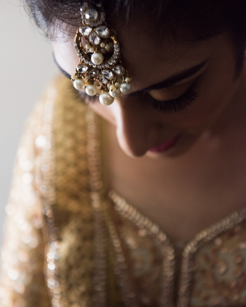 Shy Indian Bride Showing her Maangtikka