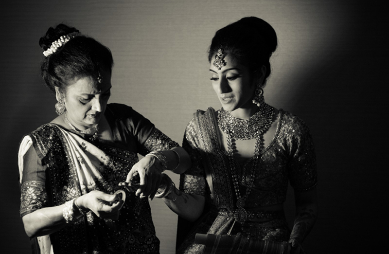 Indian Bride's Mother helping Indian Bride to Getting Ready