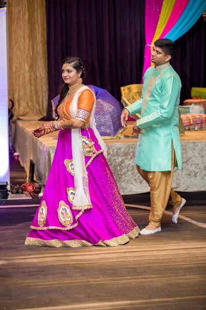 Indian Bride and Groom Doing Garba