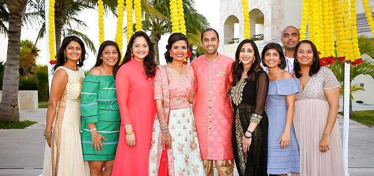 Adorable Indian bride posing with family