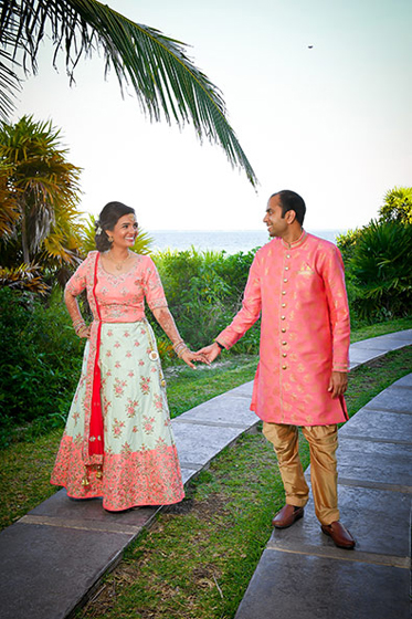 Indian bride and groom posing outdoors.