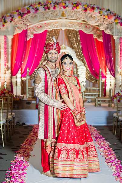 Indian Bride and Groom Capture Under Wedding Mandap