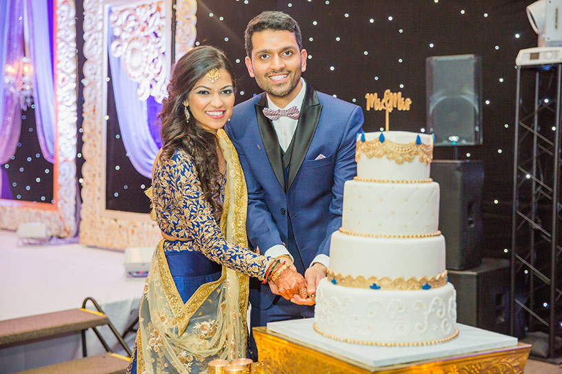 Indian Bride and Groom Cutting Cake Capture