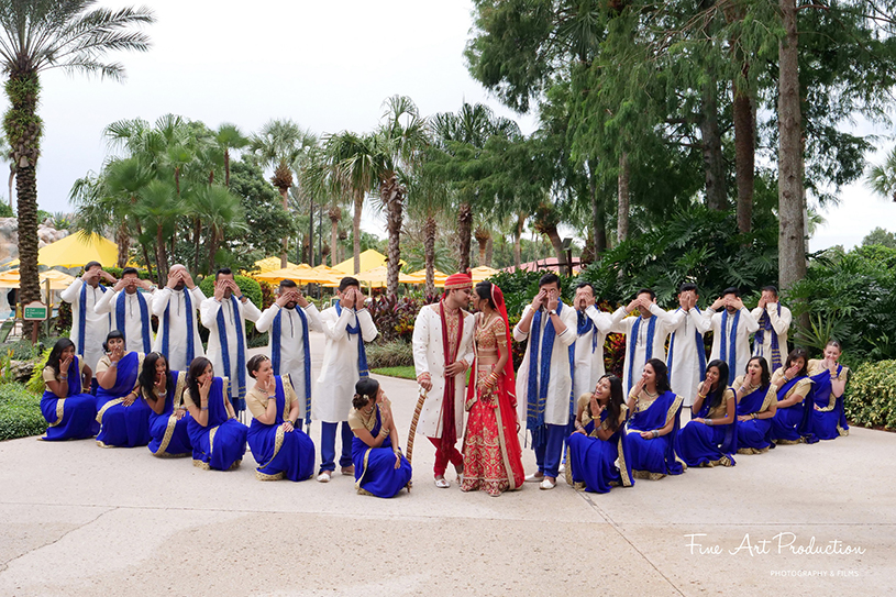 Indian Couple posing with friends and Family