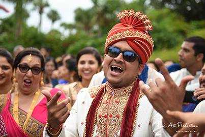 Indian Groom dancing in the baraat