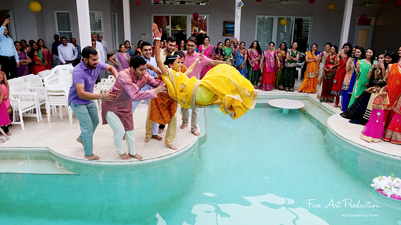 Friends Throwing the Bride in the pool after the Haldi