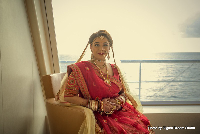 Gorgeous Indian bride with her wedding lehenga