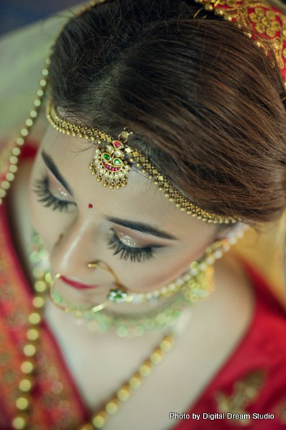 Shot of the amazing bride wearing the tikka