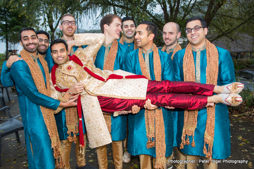 Friends carrying Groom just to have fun