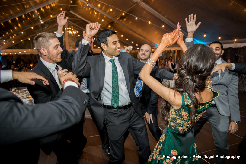 Indian Bride and Groom Dancing at Reception