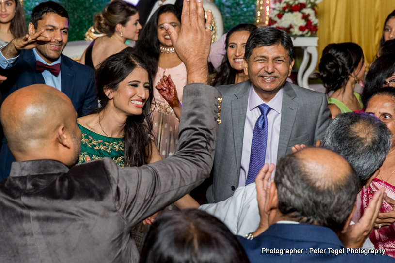 Family Members welcoming indian Bride