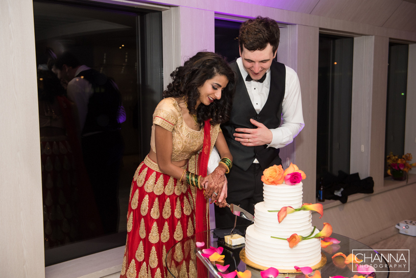 Wedding couple cutting cake during Reception Ceremony