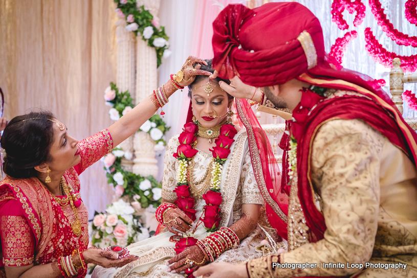Indian groom applying sindoor