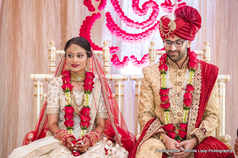 Indian couple sitting in the mandap