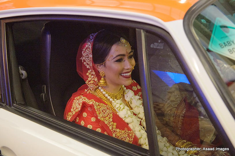 Indian Bride riding in an attractive car