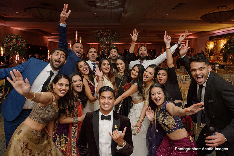 Indian Bride and groom having fun with friends and family