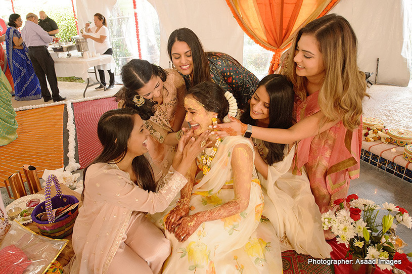 Friends applying haldi to the Bride to be