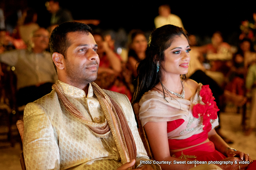 Indian Couple attending the wedding ceremony