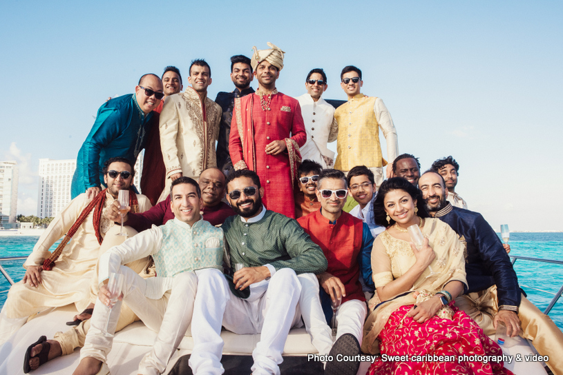 Indian Groom with his family posing outdoors