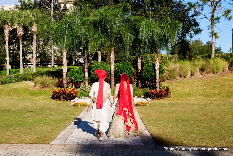 Indian Couple walking to the ceremony