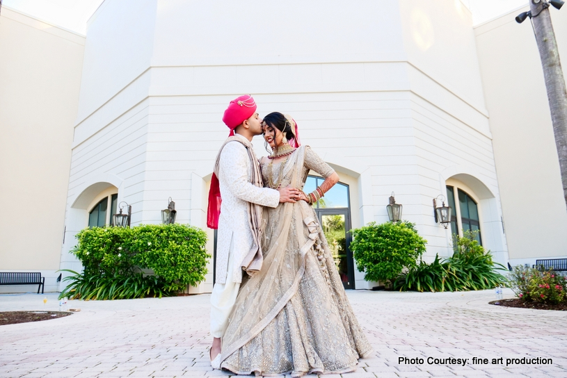 Indian Groom Kissing to Indian Bride