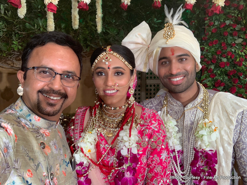 Indian Newly Weds posing with the Friend