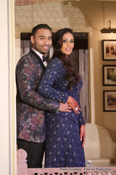 Indian Couple posing before the sangeet ceremony