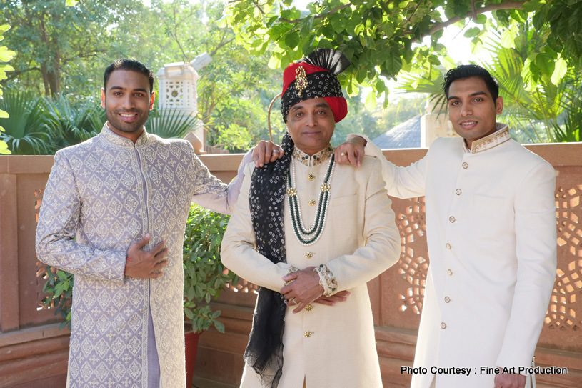Indian groom posing with father and brother
