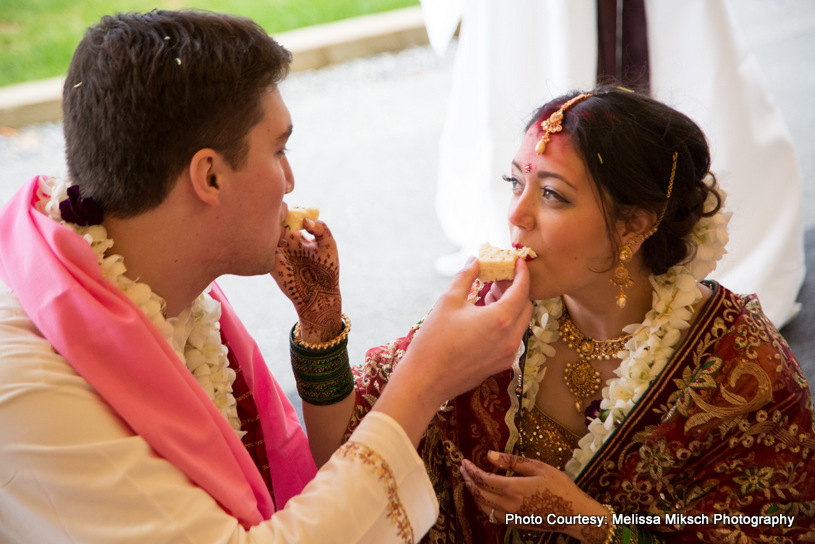 Wedding Couple feeding each other with sweet