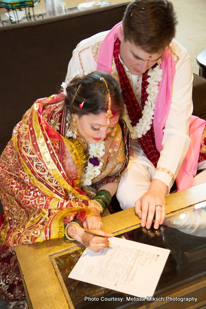 Couple signing in Marriage Register Form