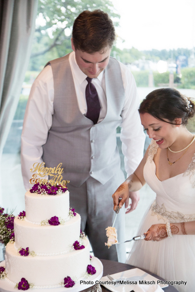 Love Birds cutting wedding cake