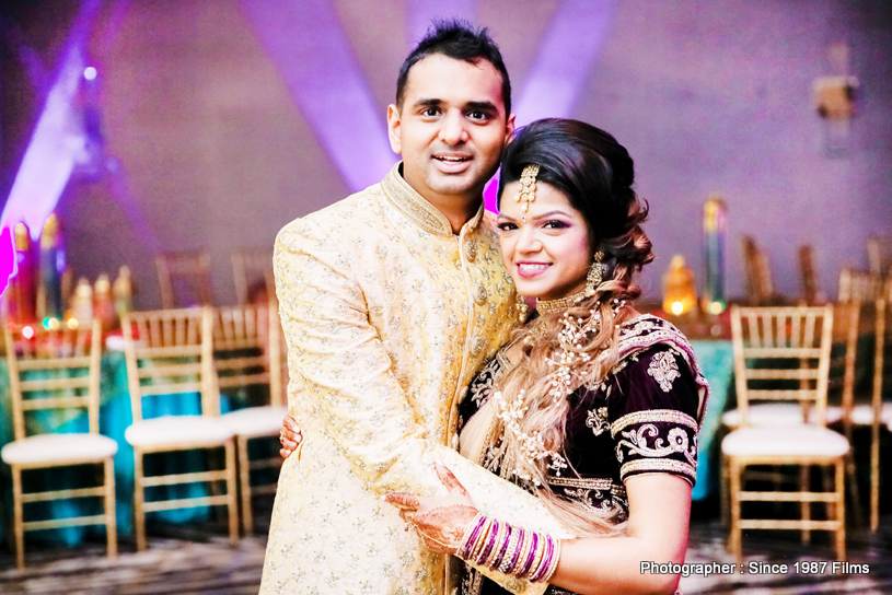 Indian Bride and groom smiling during photoshoot