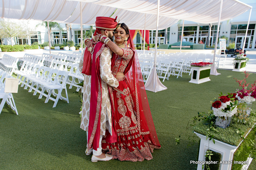 Indian Bride and Groom Hugging to each other capture