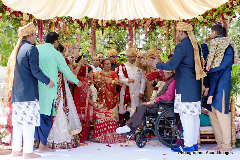 Indian Wedding Guest with Indian Bride and Groom
