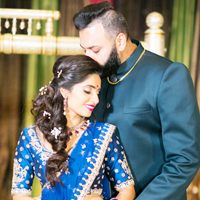 Indian Groom Kissing Brides Forehead