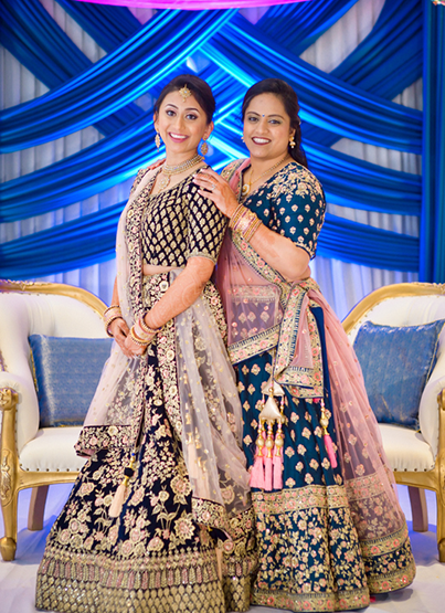 Bride posing with her cousin