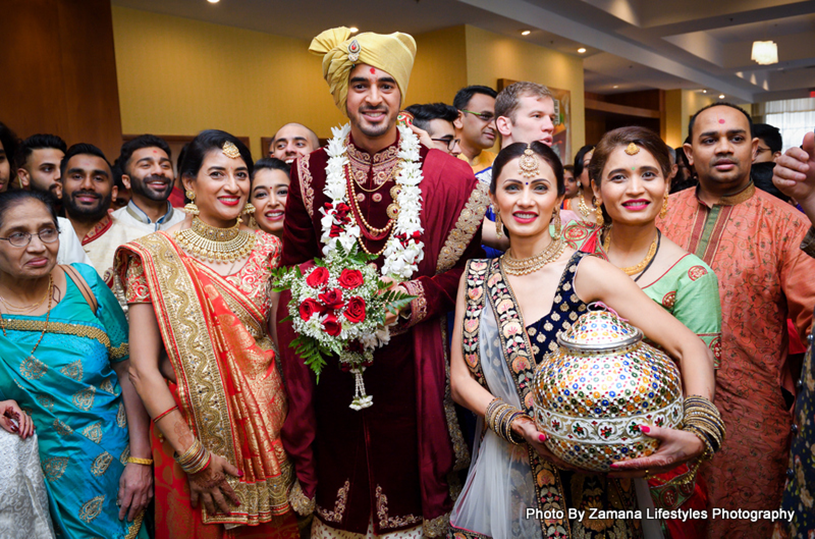 Groom posing with the family members