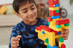 Young boy playing Lego