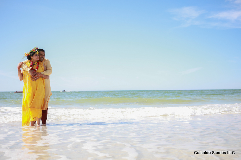 Gorgeous Pose by indian Couple in Haldi Outfit